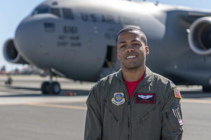Capt. Jeff Jordan, 321st Air Mobility Operations Squadron, poses in front of a C-17 Globemaster III.